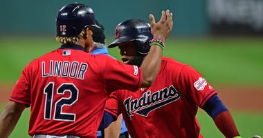 Sep 19, 2019; Cleveland, OH, USA; Cleveland Indians short stop Francisco Lindor (12), left, is congratulated by first basemen Carlos Santana (41) after scoring on a sacrifice fly by Santana during the first inning against the Detroit Tigers at Progressive