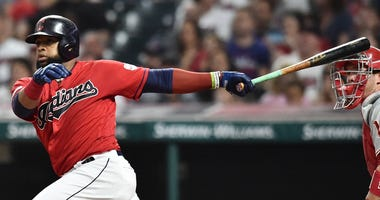 Sep 20, 2019; Cleveland, OH, USA; Cleveland Indians first baseman Carlos Santana (41) hits an RBI single during the second inning against the Philadelphia Phillies at Progressive Field. Mandatory Credit: Ken Blaze-USA TODAY Sports