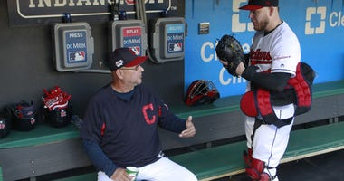 Cleveland Indians manager Terry Francona (left) talks with catcher Roberto Perez (55) in the dugout before the game against the Philadelphia Phillies at Progressive Field. Mandatory Credit: Charles LeClaire-USA TODAY Spor