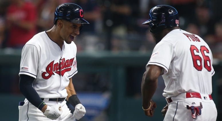 Sep 22, 2019; Cleveland, OH, USA; Cleveland Indians center fielder Oscar Mercado (left) celebrates his three run home run with right fielder Yasiel Puig (right) against the Philadelphia Phillies during the fifth inning at Progressive Field. Mandatory Cred