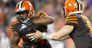 Cleveland Browns quarterback Baker Mayfield (6) hands the ball off to running back Nick Chubb (24) during the first quarter against the Los Angeles Rams at FirstEnergy Stadium.