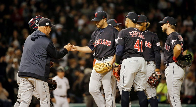Cleveland Indians starting pitcher Aaron Civale (67) gives the ball to manager Terry Francona (77) as he is taken out of the game after giving up back to back home runs to the Chicago White Sox during the fourth inning at Guaranteed Rate Field.