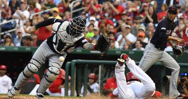 Sep 28, 2019; Washington, DC, USA; Cleveland Indians catcher Eric Haase (38) is unable to catch the throw allowing Washington Nationals left fielder Juan Soto (22) to score during the fourth inning at Nationals Park. Mandatory Credit: Brad Mills-USA TODAY