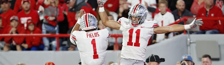 Ohio State Buckeyes wide receiver Austin Mack (11) celebrates with quarterback Justin Fields (1) after scoring against the Nebraska Cornhuskers in the first half at Memorial Stadium.