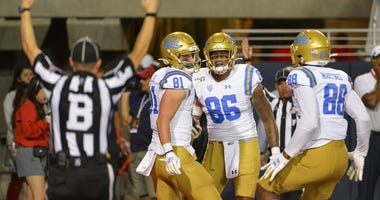 UCLA Bruins tight end Matt Lynch (81) tight end Devin Asiasi (86) and tight end Mike Martinez (88) celebrate a touchdown against the Arizona Wildcats during the first half at Arizona Stadium.