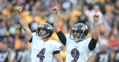 Baltimore Ravens punter Sam Koch (4) and kicker Justin Tucker (9) react after a game winning field goal by Tucker to defeat the Pittsburgh Steelers in overtime at Heinz Field.