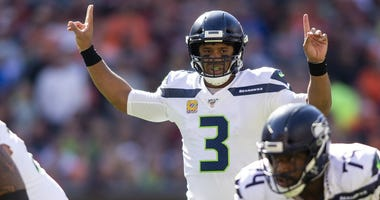 Oct 13, 2019; Cleveland, OH, USA; Seattle Seahawks quarterback Russell Wilson (3) signals from the backfield during the first quarter against the Cleveland Browns at FirstEnergy Stadium. Mandatory Credit: Scott R. Galvin-USA TODAY Sports