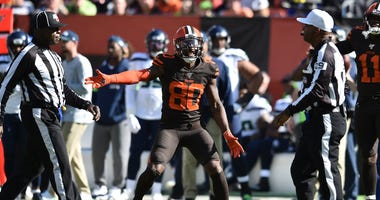 Cleveland Browns wide receiver Jarvis Landry (80) argues with field judge Adrian Hill (29) about a blocking foul during the second half against the Seattle Seahawks at FirstEnergy Stadium.