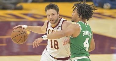 Oct 15, 2019; Cleveland, OH, USA; Cleveland Cavaliers guard Matthew Dellavedova (18) drives against Boston Celtics guard Carsen Edwards (4) in the first quarter at Rocket Mortgage FieldHouse. Mandatory Credit: David Richard-USA TODAY Sports