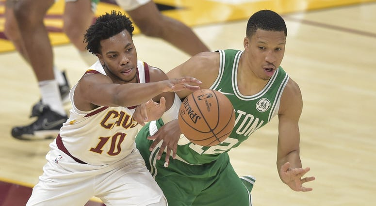 Oct 15, 2019; Cleveland, OH, USA; Boston Celtics forward Grant Williams (12) knocks the ball from Cleveland Cavaliers guard Darius Garland (10) in the third quarter at Rocket Mortgage FieldHouse. Mandatory Credit: David Richard-USA TODAY Sports