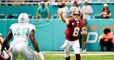 Washington Redskins quarterback Case Keenum (8) against the Miami Dolphins during the first half at Hard Rock Stadium.