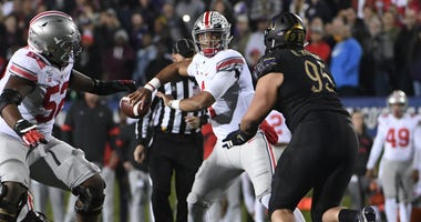 Ohio State Buckeyes quarterback Justin Fields (1) looks to pass against the Northwestern Wildcats during the first half at Ryan Field.