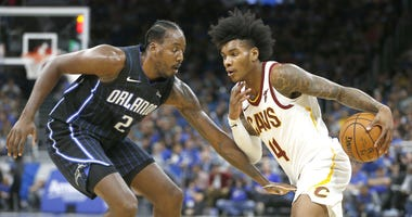 Oct 23, 2019; Orlando, FL, USA; Orlando Magic forward Al-Farouq Aminu (2) guards against Cleveland Cavaliers guard Kevin Porter Jr. (4) during the second half at Amway Center. Mandatory Credit: Reinhold Matay-USA TODAY Sports