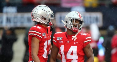 Ohio State Buckeyes wide receiver Chris Olave (17) celebrates with Ohio State Buckeyes wide receiver K.J. Hill (14)