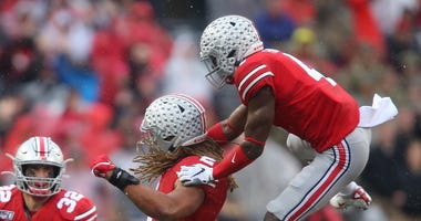 Ohio State Buckeyes defensive end Chase Young (middle) is congratulated by safety Jordan Fuller (4) during the third quarter against the Wisconsin Badgers at Ohio Stadium.
