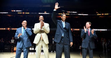 Oct 26, 2019; Cleveland, OH, USA; Former Cleveland Cavaliers players (left to right) Austin Carr and Larry Nance and Brad Daugherty and Mark Price are introduced as part of the Cleveland Cavaliers 50th anniversary festivities. Ken Blaze-USA TODAY Sports
