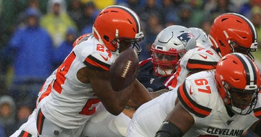 Cleveland Browns running back Nick Chubb (24) fumbles the ball during the first quarter against the New England Patriots at Gillette Stadium.