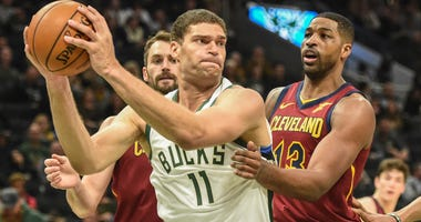 Kevin Love, and TT guarding Brook Lopez