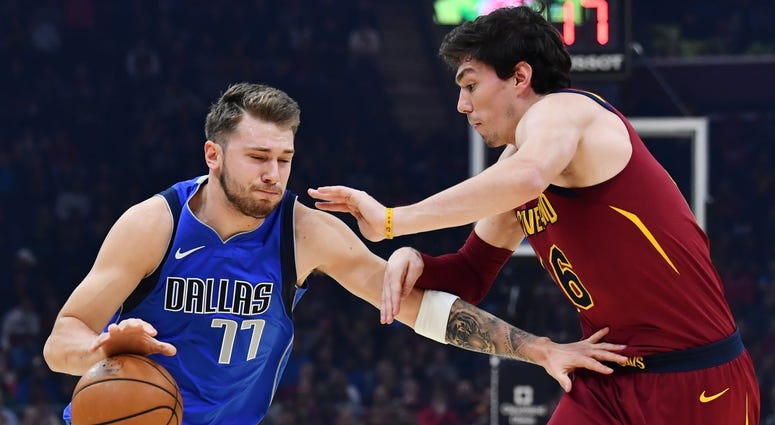 Nov 3, 2019; Cleveland, OH, USA; Dallas Mavericks guard Luka Doncic (77) drives to the basket against Cleveland Cavaliers forward Cedi Osman (16) during the first half at Rocket Mortgage FieldHouse. Mandatory Credit: Ken Blaze-USA TODAY Sports