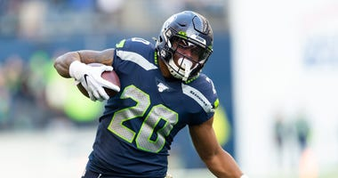 Nov 3, 2019; Seattle, WA, USA; Seattle Seahawks running back Rashaad Penny (20) carries the ball against the Tampa Bay Buccaneers during the second half at CenturyLink Field. Seattle defeated Tampa Bay 40-34. Mandatory Credit: Steven Bisig-USA TODAY Sport