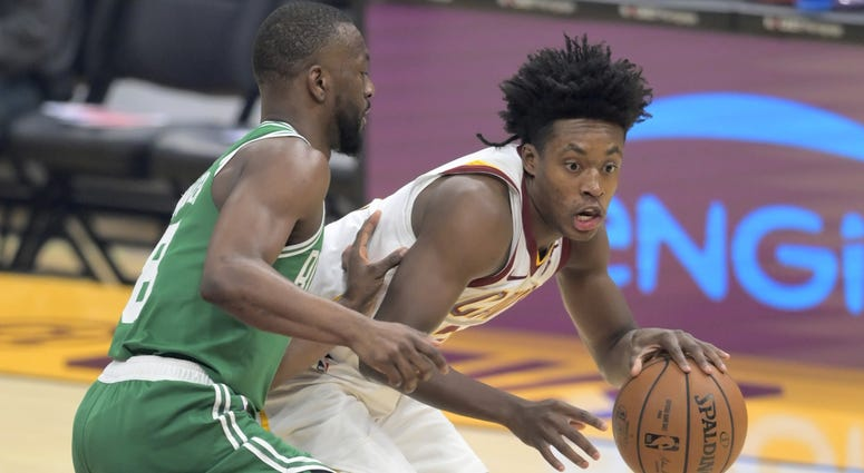Boston Celtics guard Kemba Walker (8) defends Cleveland Cavaliers guard Collin Sexton (2) in the first quarter at Rocket Mortgage FieldHouse.