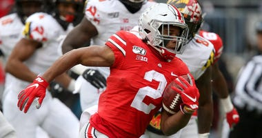 Nov 9, 2019; Columbus, OH, USA; Ohio State Buckeyes running back J.K. Dobbins (2) runs for a touchdown against the Maryland Terrapins during the second quarter at Ohio Stadium. Mandatory Credit: Joe Maiorana-USA TODAY Sports