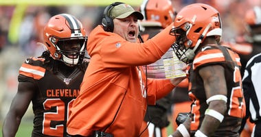 Cleveland Browns head coach Freddie Kitchens celebrates with the defense after a stop against the Buffalo Bills during the second half at FirstEnergy Stadium.
