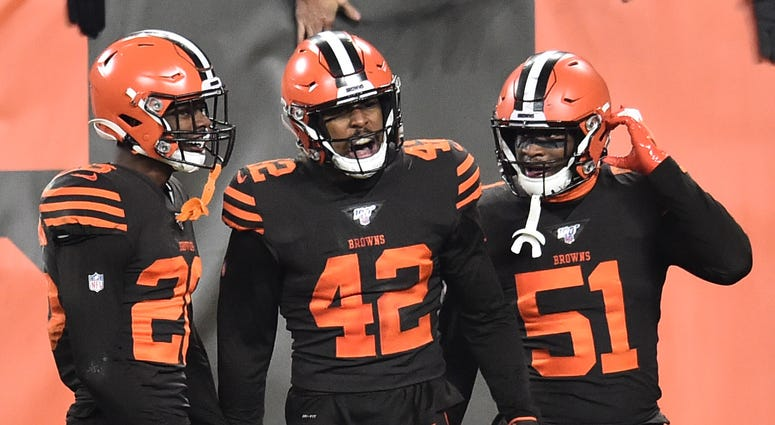 Cleveland Browns strong safety Morgan Burnett (42) celebrates with free safety Damarious Randall (23) and linebacker Mack Wilson (51)
