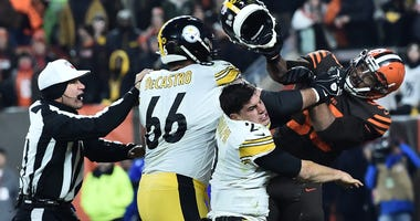 Cleveland Browns defensive end Myles Garrett (95) hits Pittsburgh Steelers quarterback Mason Rudolph (2) with his own helmet as offensive guard David DeCastro (66) tries to stop Garrett during the fourth quarter.