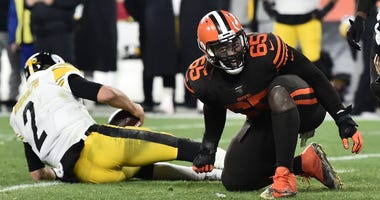 Cleveland Browns defensive tackle Larry Ogunjobi (65) celebrates after sacking Pittsburgh Steelers quarterback Mason Rudolph (2) during the second half at FirstEnergy Stadium.