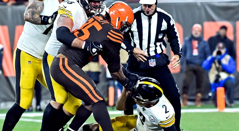 Nov 14, 2019; Cleveland, OH, USA; Cleveland Browns defensive end Myles Garrett (95) hits Pittsburgh Steelers quarterback Mason Rudolph (2) with his own helmet as offensive guard David DeCastro (66) tries to stop Garrett during the fourth quarter at FirstE