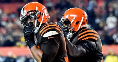 Cleveland Browns defensive end Myles Garrett (left)