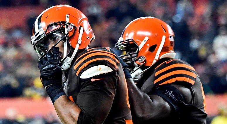 Cleveland Browns defensive end Myles Garrett (left)