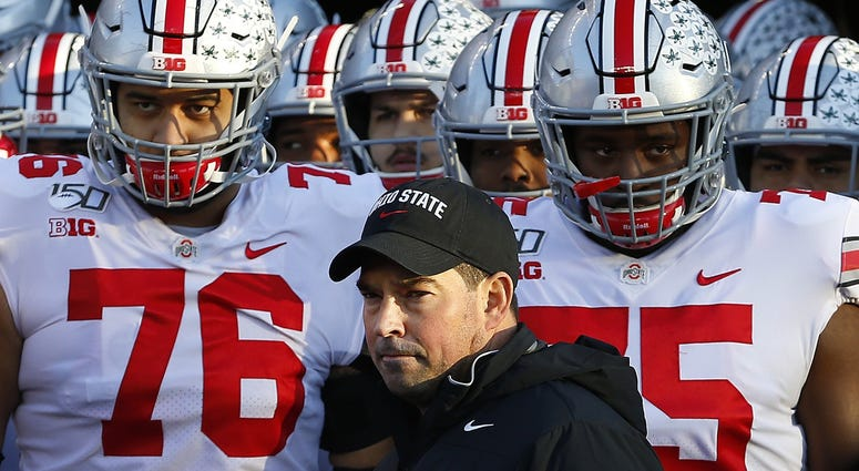 Ohio State Buckeyes head coach Ryan Day stands with players before a game against the Rutgers Scarlet Knights at SHI Stadium.