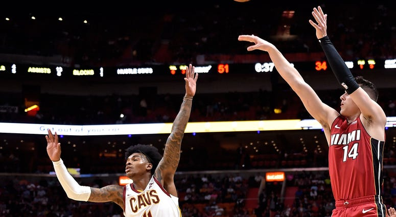 Miami Heat forward Duncan Robinson (55) shoots a three point basket over Cleveland Cavaliers guard Kevin Porter Jr. (4)