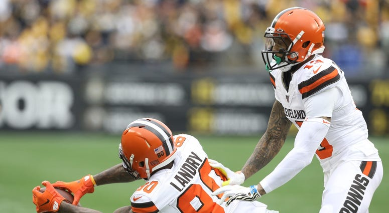 Dec 1, 2019; Pittsburgh, PA, USA; Cleveland Browns wide receiver Jarvis Landry (80) makes a catch on the sidelines in front of wide receiver Odell Beckham (13) against the Pittsburgh Steelers during the first quarter at Heinz Field.