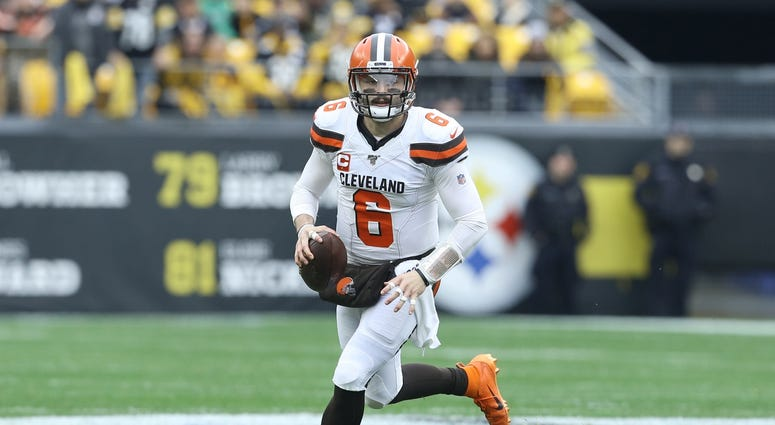 Dec 1, 2019; Pittsburgh, PA, USA; Cleveland Browns quarterback Baker Mayfield (6) scrambles with the ball against the Pittsburgh Steelers during the first quarter at Heinz Field. Mandatory Credit: Charles LeClaire-USA TODAY Sports