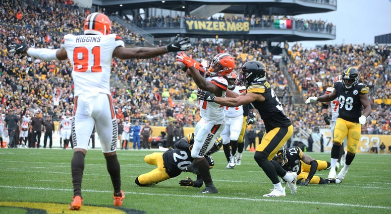 Dec 1, 2019; Pittsburgh, PA, USA; Cleveland Browns running back Kareem Hunt (27) scores a touchdown past Pittsburgh Steelers cornerback Cameron Sutton (20) and free safety Minkah Fitzpatrick (39) during the second quarter at Heinz Field. Mandatory Credit: