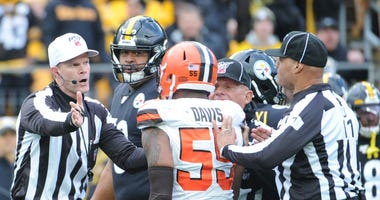 NFL officials separate players of the Cleveland browns and Pittsburgh Steelers