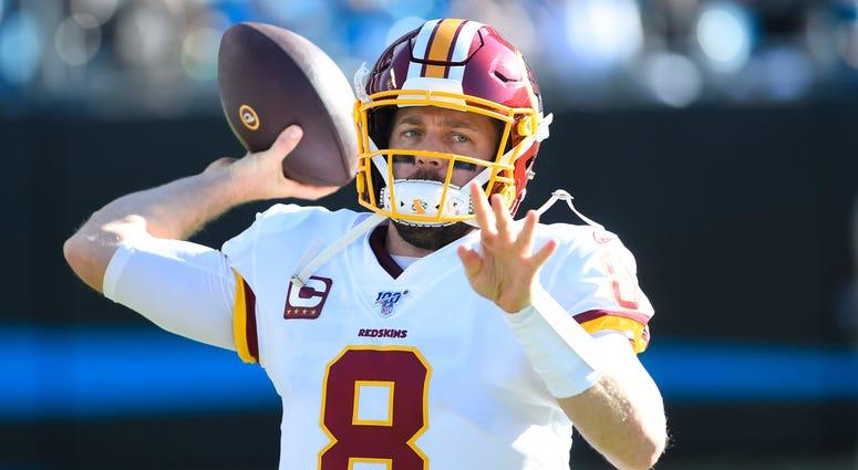 Washington Redskins quarterback Case Keenum (8) warms up in the second quarter at Bank of America Stadium.
