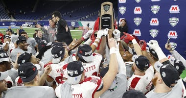 Players from the Miami Redhawks hold up the trophy after winning the MAC Championship game against the Central Michigan Chippewas at Ford Field.