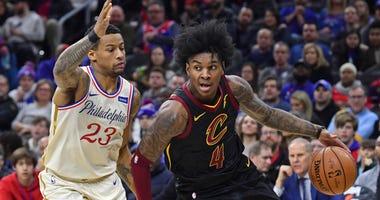 Cleveland Cavaliers guard Kevin Porter Jr. (4) drives to the basket against Philadelphia 76ers guard Trey Burke (23)