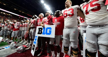 Dec 7, 2019; Indianapolis, IN, USA; Ohio State Buckeyes celebrate after defeating the Wisconsin Badgers 34-21 in the 2019 Big Ten Championship Game at Lucas Oil Stadium. Mandatory Credit: Thomas J. Russo-USA TODAY Sports