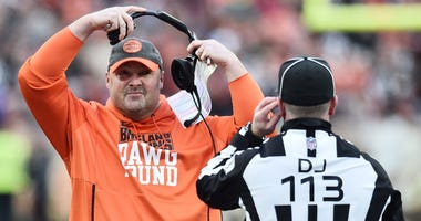 Cleveland Browns head coach Freddie Kitchens talks with down judge Danny Short during the second half against the Cincinnati Bengals at FirstEnergy Stadium.