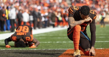 Dec 8, 2019; Cleveland, OH, USA; Cleveland Browns wide receiver Odell Beckham (13) and wide receiver Jarvis Landry (80) take a moment before the game against the Cincinnati Bengals at FirstEnergy Stadium. Mandatory Credit: Scott R. Galvin-USA TODAY Sports