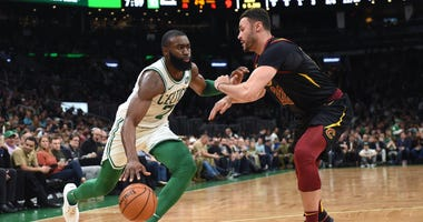 Dec 9, 2019; Boston, MA, USA; Boston Celtics guard Jaylen Brown (7) controls the ball while Cleveland Cavaliers forward Larry Nance Jr. (22) defends during the first half at TD Garden. Mandatory Credit: Bob DeChiara-USA TODAY Sports
