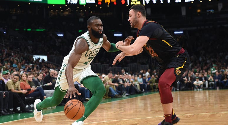 Dec 9, 2019; Boston, MA, USA; Boston Celtics guard Jaylen Brown (7) controls the ball while Cleveland Cavaliers forward Larry Nance Jr. (22) defends during the first half at TD Garden. Mandatory Credit: Bob DeChiara-USA TODAY Sports
