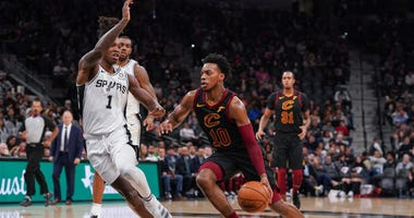 Dec 12, 2019; San Antonio, TX, USA; Cleveland Cavaliers guard Darius Garland (10) dribbles the ball around against San Antonio Spurs guard Lonnie Walker IV (1) in the first half at the AT&T Center. Mandatory Credit: Daniel Dunn-USA TODAY Sports