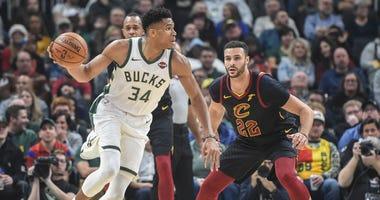 Milwaukee Bucks forward Giannis Antetokounmpo (34) drives for the basket against Cleveland Cavaliers forward Larry Nance Jr. (22)