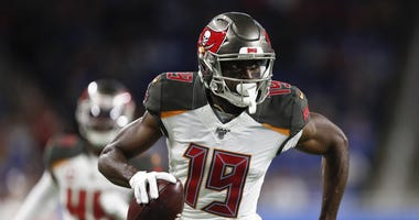 Dec 15, 2019; Detroit, MI, USA; Tampa Bay Buccaneers wide receiver Breshad Perriman (19) runs after a catch for his second touchdown during the second quarter against the Detroit Lions at Ford Field. Mandatory Credit: Raj Mehta-USA TODAY Sports